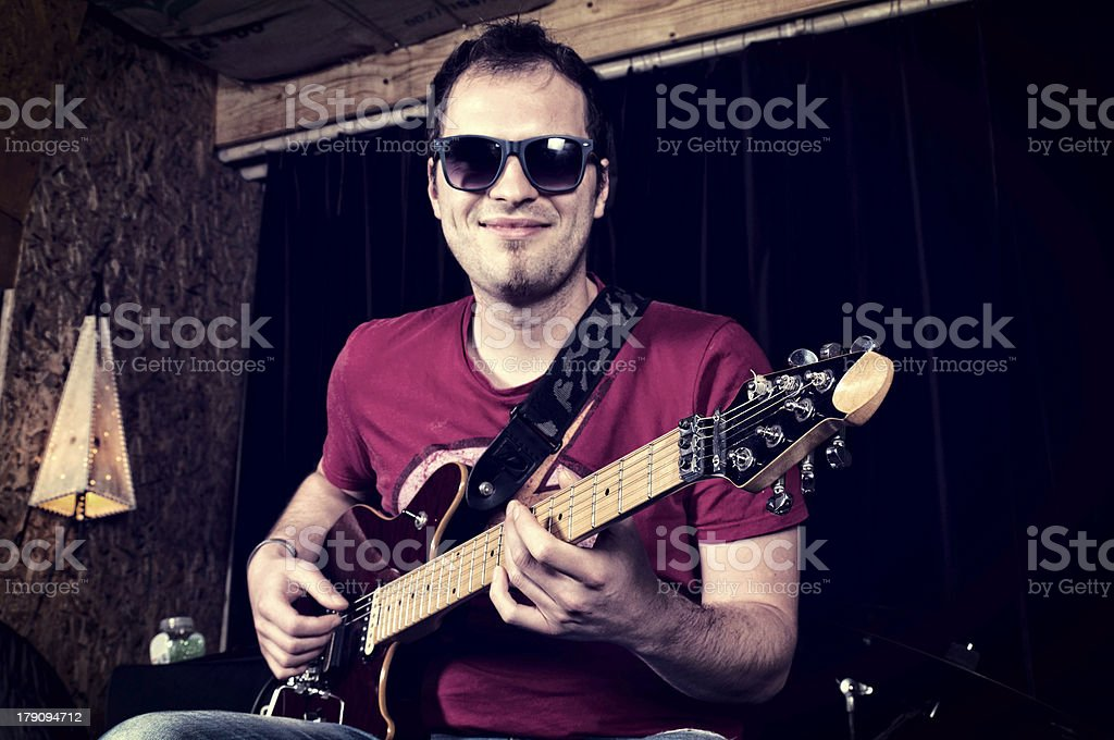 Man playing the guitar royalty-free stock photo