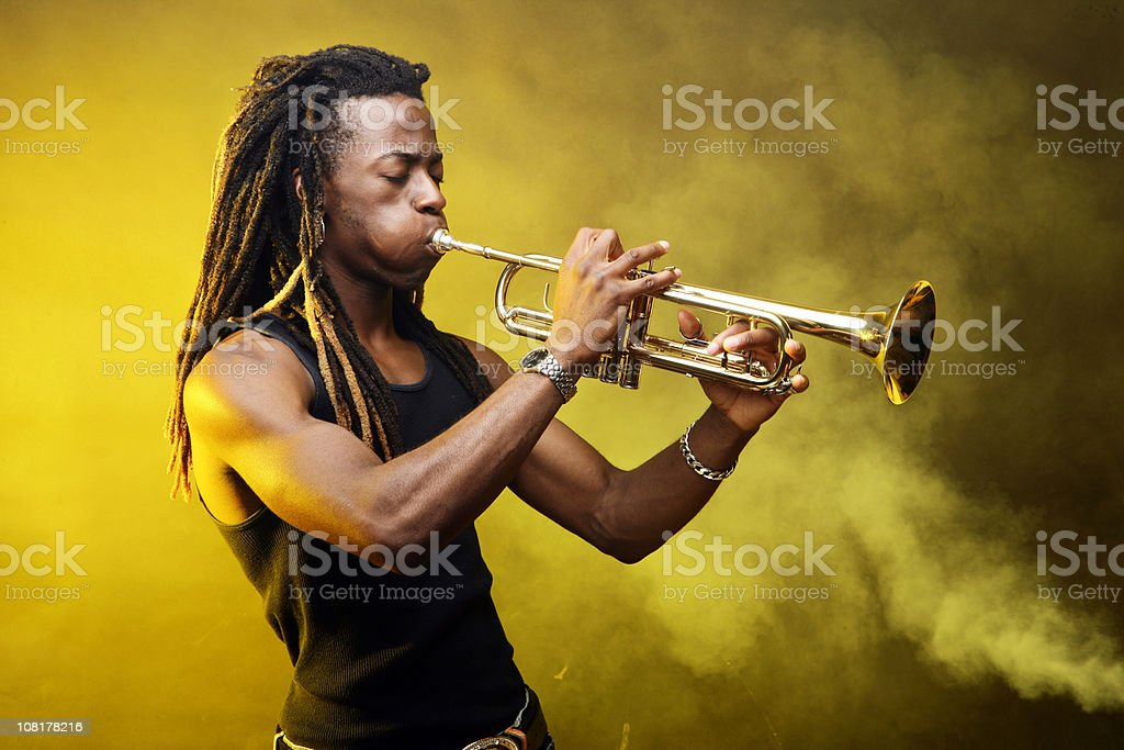 Man Playing Trumpet on Stage stock photo