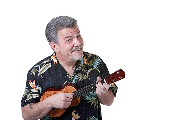 mann spielt ukulele - ukulele songs stock-fotos und bilder