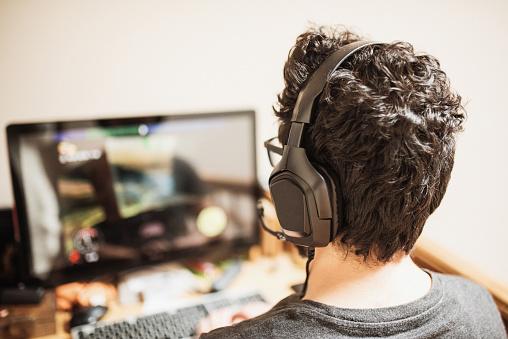 istock Man playing videogames 1219199077