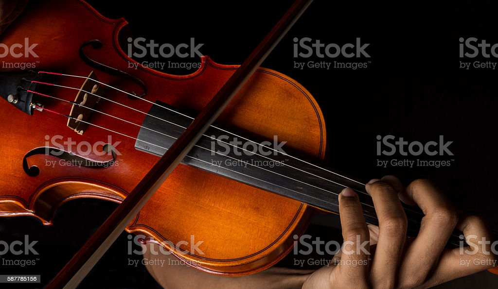 Man playing violin holding the bow stock photo