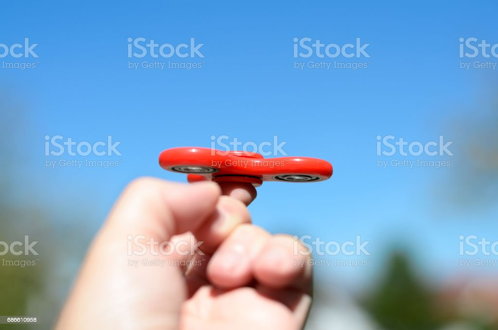 Man playing with a fidget spinner royalty-free stock photo