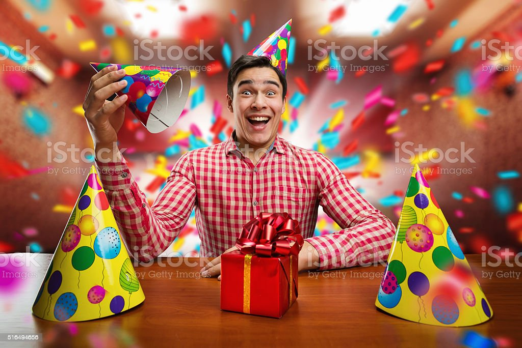 Man playing with Birthday hats stock photo