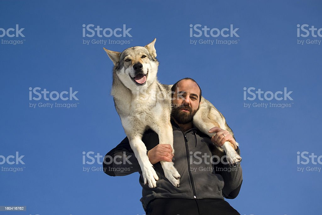 Man playing with dog royalty-free stock photo