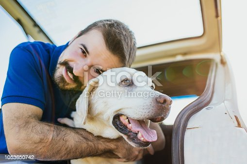 937331052istockphoto Man playing with his dog 1053650742