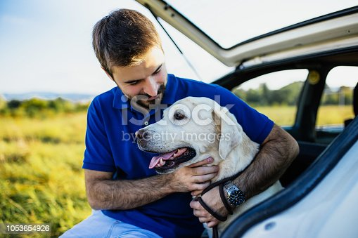 937331052istockphoto Man playing with his dog 1053654926