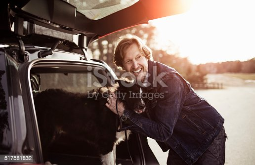 517930062 istock photo Man playing with his dog 517581832