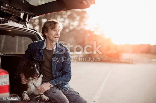 istock Man playing with his dog 517930062
