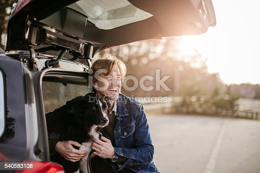 517930062 istock photo Man playing with his dog 540583108