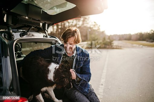 517930062 istock photo Man playing with his dog 599673266
