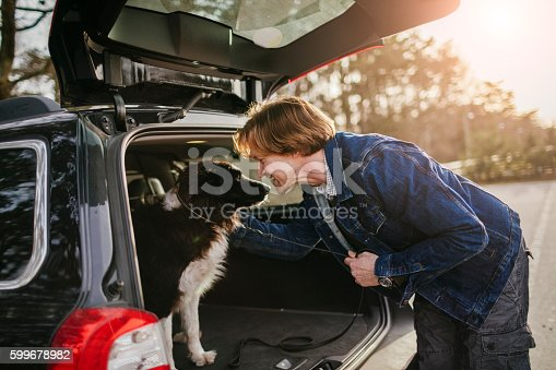 517930062 istock photo Man playing with his dog 599678982