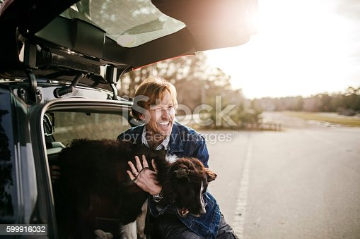 517930062 istock photo Man playing with his dog 599916032