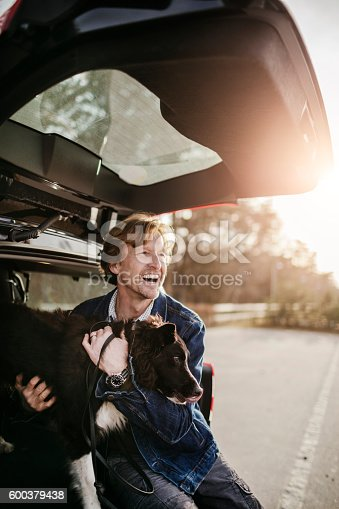 517930062 istock photo Man playing with his dog 600379438