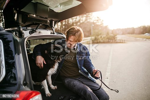 517930062 istock photo Man playing with his dog 601924026
