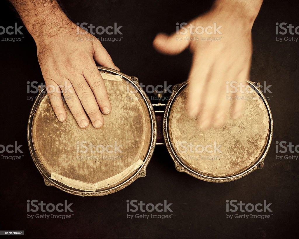 man playing worn bongos stock photo