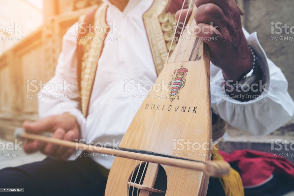 Man Plays Croatian Musical Instrument in Dubrovnik stock photo
