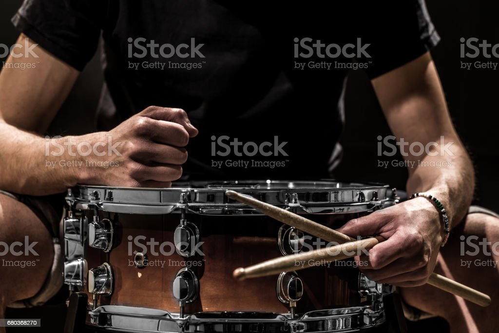 man plays musical percussion instrument with sticks a musical concept with the working drum royalty-free stock photo