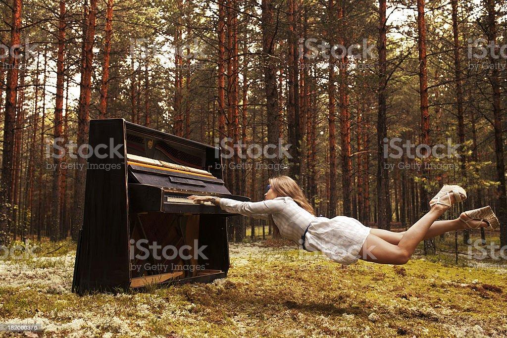 man plays the piano stock photo