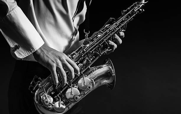 man plays the saxophone - caz stok fotoğraflar ve resimler
