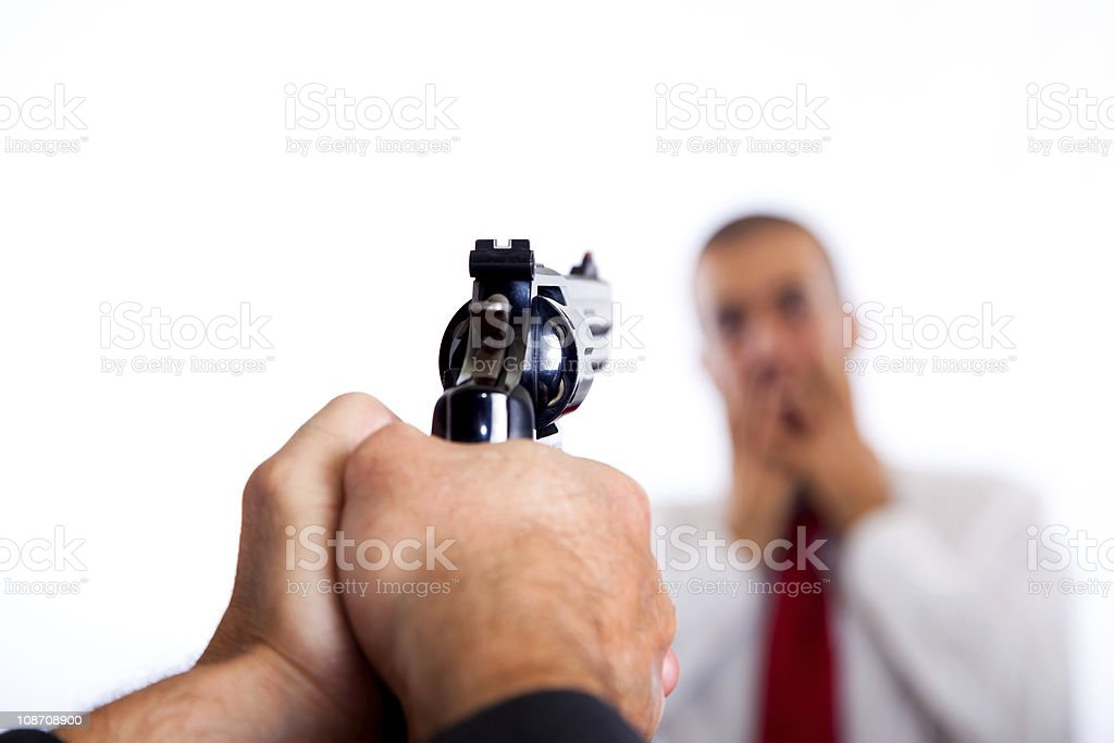 Man Point a Gun on Young Terrorized Businessman stock photo