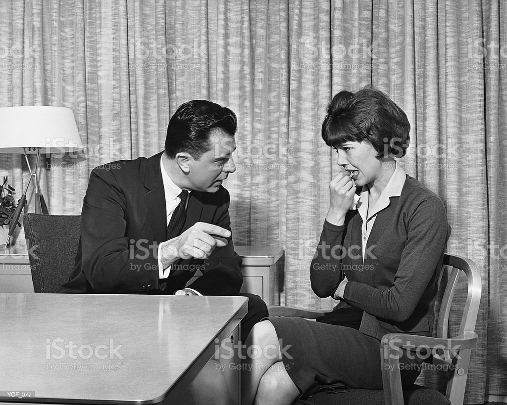 Man pointing and talking to upset woman royalty-free stock photo