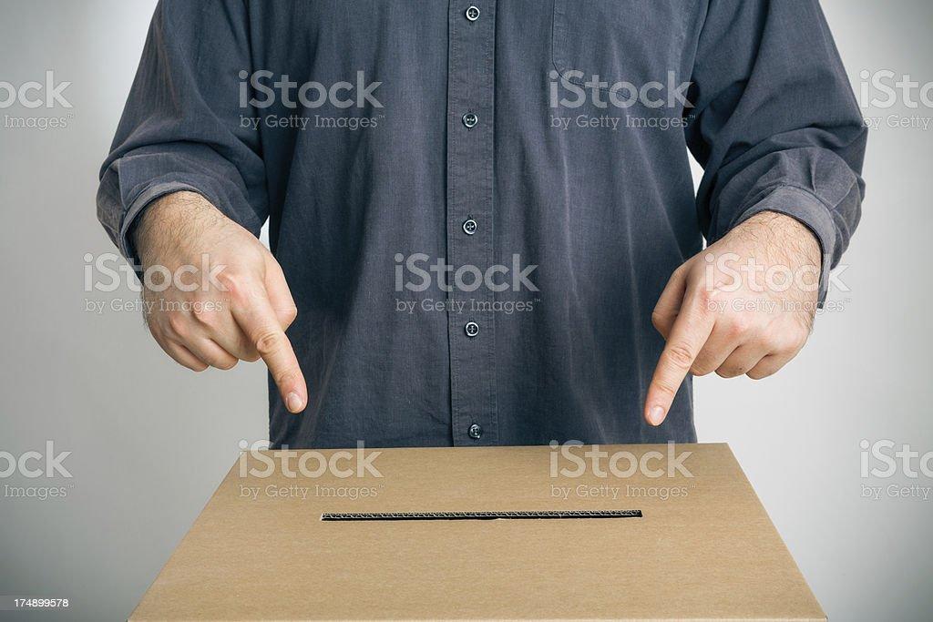 man pointing at ballot box royalty-free stock photo