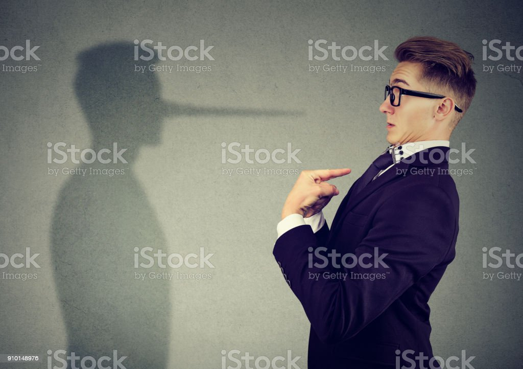 Man pointing at himself while lying stock photo
