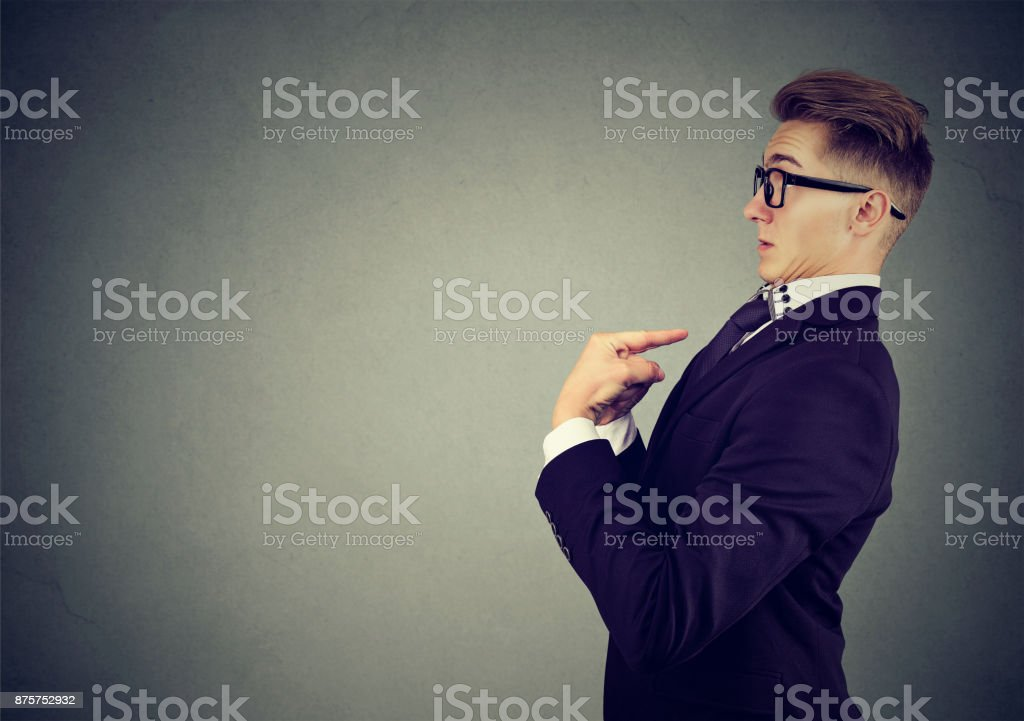 Man pointing fingers at himself denies responsibility and accusations stock photo