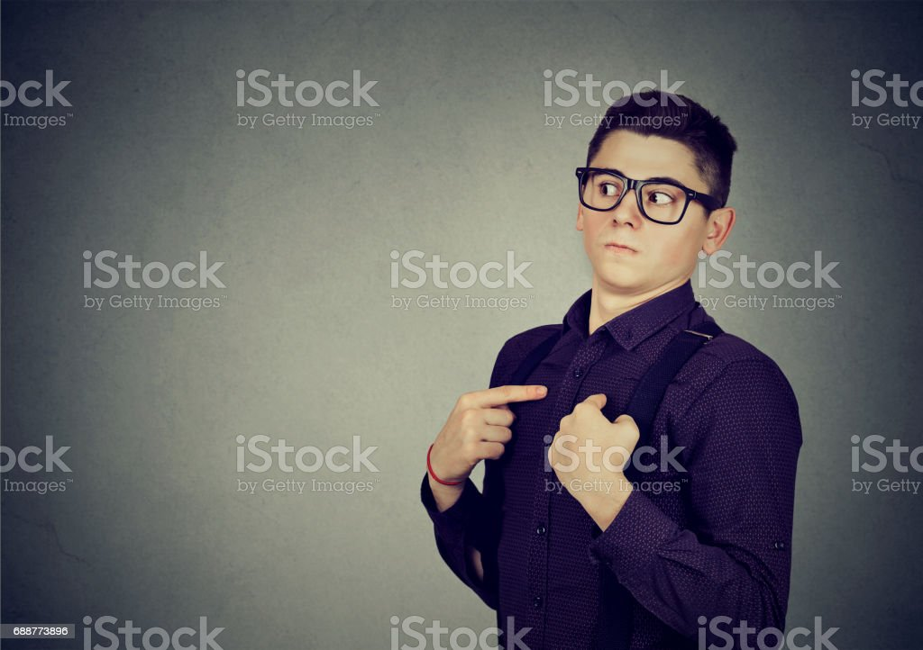 Man pointing fingers at himself denies responsibility stock photo