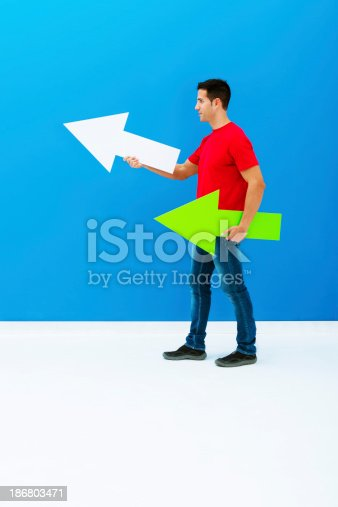 168589045istockphoto Man pointing forward with arrows 186803471