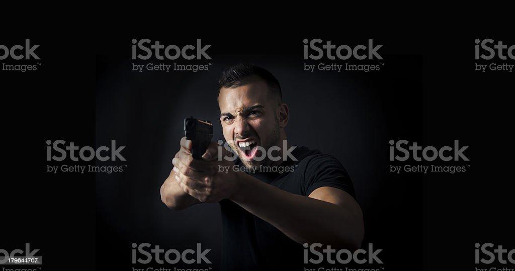 Man pointing gun royalty-free stock photo