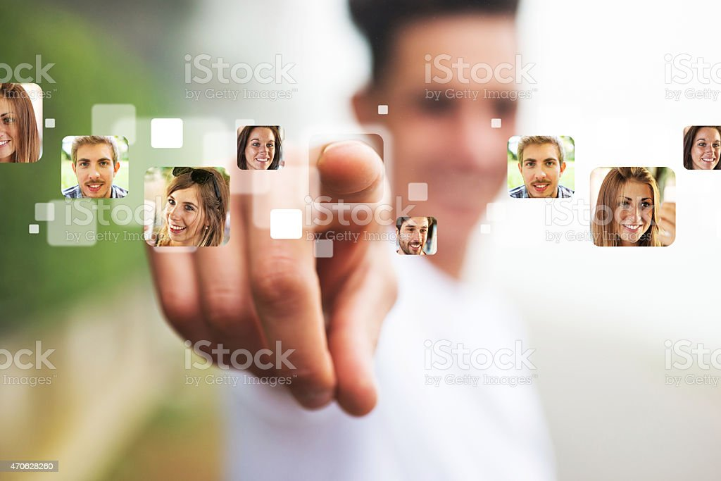 Man pointing his Finger on People's Photographs stock photo