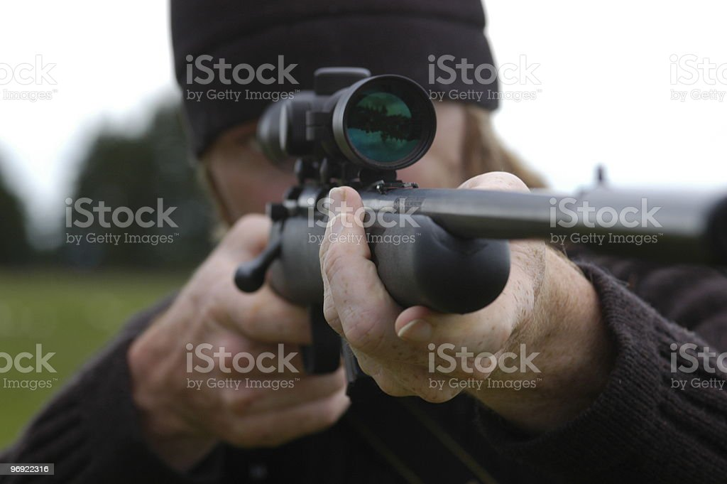 Man pointing his rifle royalty-free stock photo