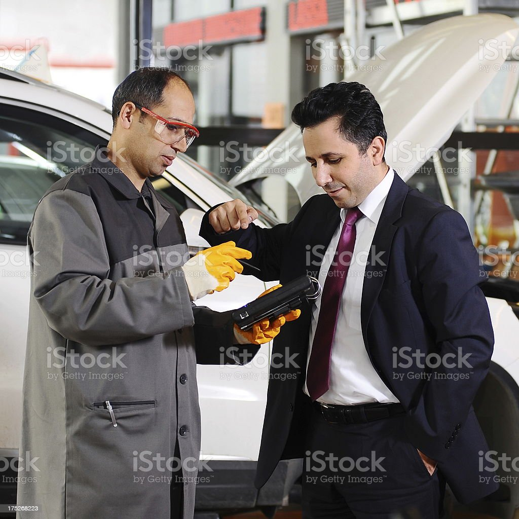Man pointing on electric device royalty-free stock photo