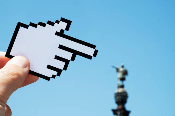 man pointing the columbus monument in barcelona - mouse pointer stock photos and pictures