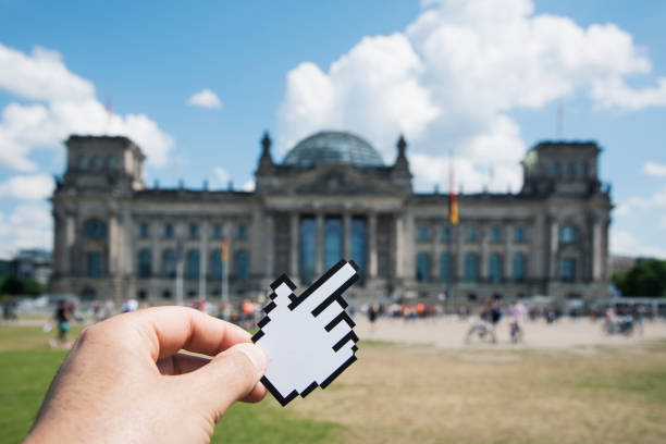 man pointing the reichstag in berlin, germany - mouse pointer stock photos and pictures