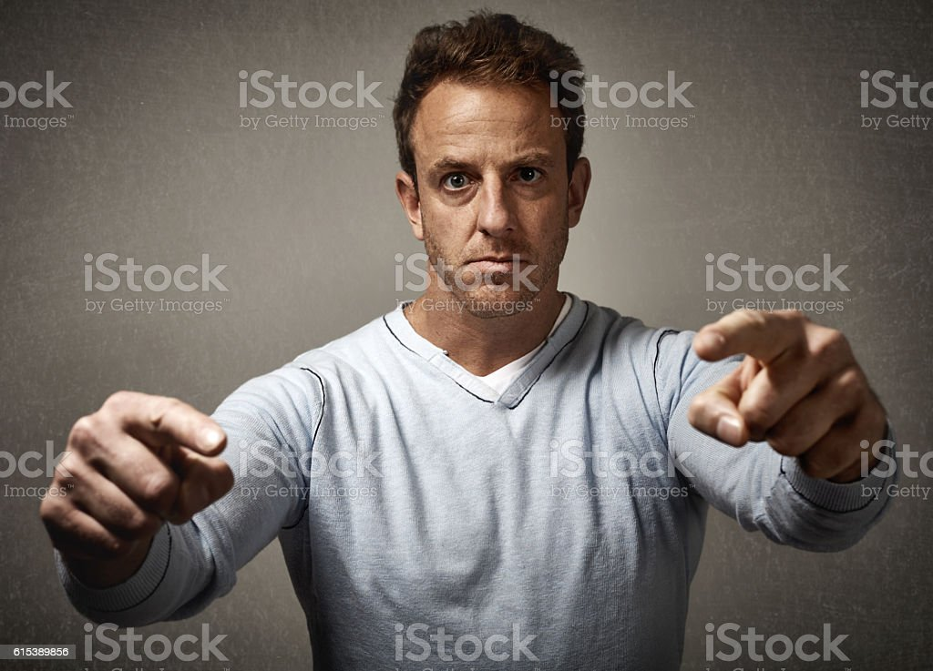 Man pointing to the camera. stock photo