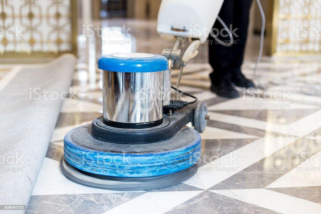 man polishing marble floor in modern office building stock photo