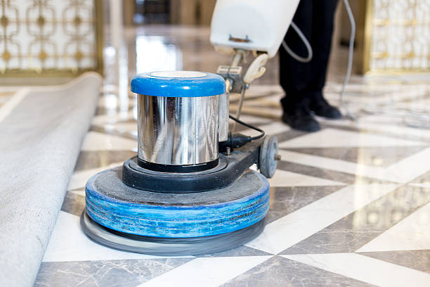 man polishing marble floor in modern office building - lustrer photos et images de collection