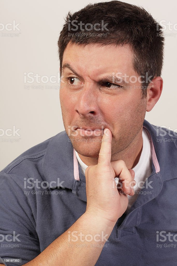Man pondering stock photo