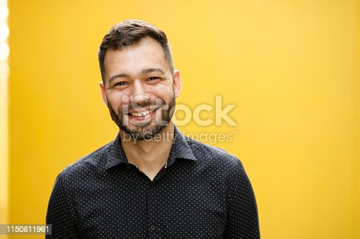 Man portrait on yellow background.