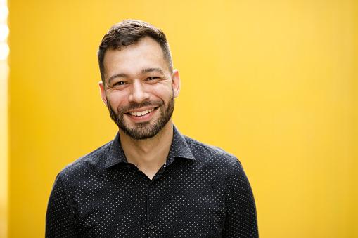 Man portrait on yellow background.