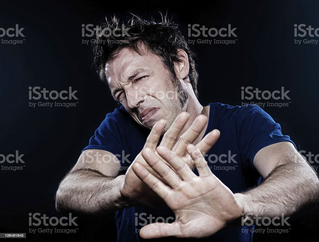 Man Portrait pucker stop shielding disgust royalty-free stock photo