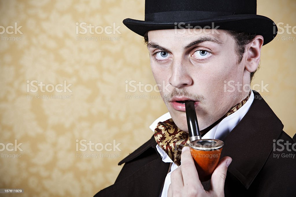 Man portraying Sherlock Holmes with pipe and hat stock photo