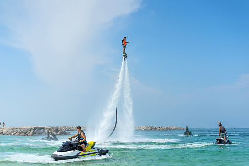 istock Man posing at new flyboard at Caribbean tropical beach. Positive human emotions, feelings, joy. Funny cute men making vacations and enjoying summer. 896897806