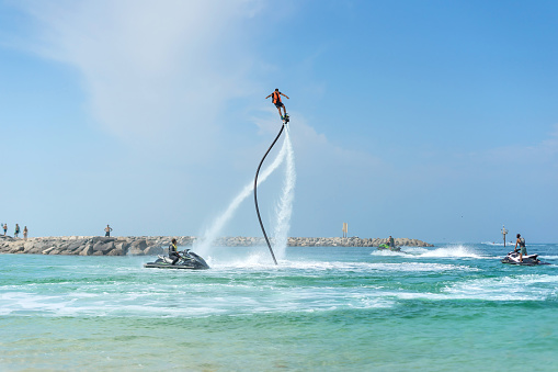 istock Man posing at new flyboard at Caribbean tropical beach. Positive human emotions, feelings, joy. Funny cute men making vacations and enjoying summer. 897805902