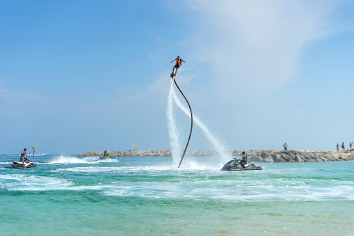 istock Man posing at new flyboard at Caribbean tropical beach. Positive human emotions, feelings, joy. Funny cute men making vacations and enjoying summer. 956926496