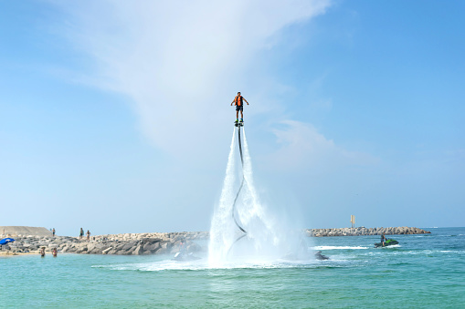 istock Man posing at new flyboard at Caribbean tropical beach. Positive human emotions, feelings, joy. Funny cute men making vacations and enjoying summer. 993159566