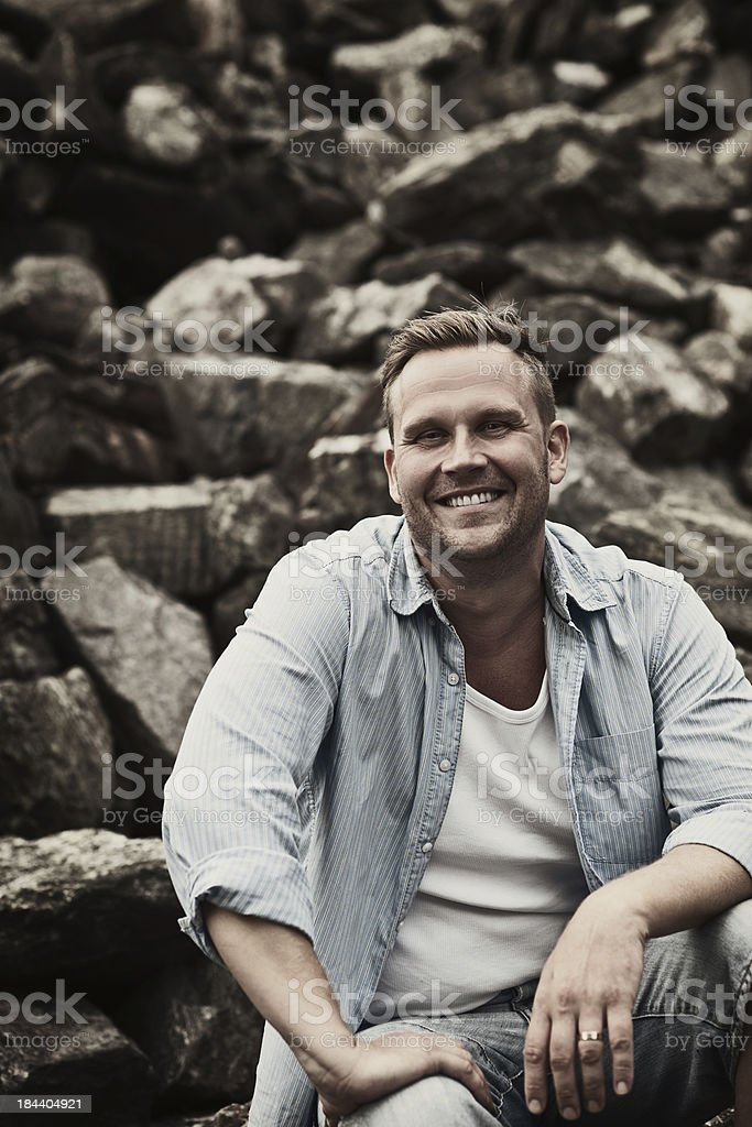 Man posing in a marble quarry stock photo