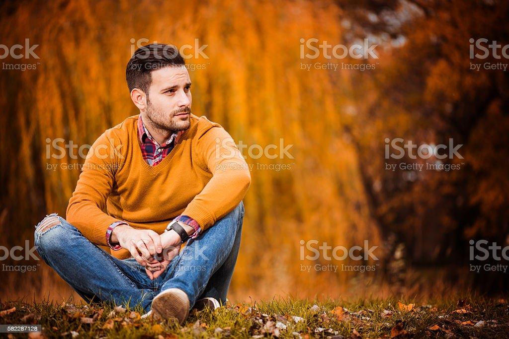 Man posing in autumn park ストックフォト